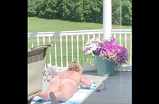 Chubby mom sunbathing