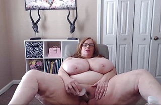 Naughty BBW with sexy glasses and enormous natural boobs