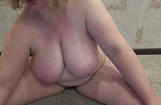 Thick milf with big tits masturbates hairy pussy in front of a webcam.