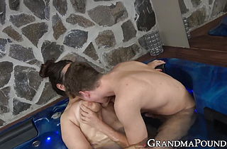 Curvy granny gets her juicy pussy fucked in the Jacuzzi